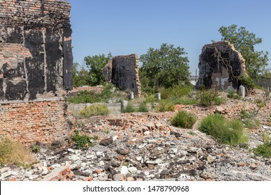 Ruined house. Remains of old houses. Apocalypse. Abandoned city. City of ghosts. Ruins of old historic houses destroyed by an earthquake and devastating operation of urban structures. Broken building