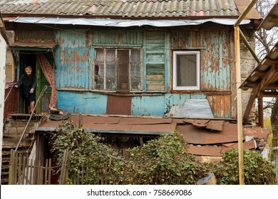 Ruined houses in poor neighborhood for poor people. Without major repairs, old houses are destroyed during a crisis. Architecture of the district. Old  house for the poor