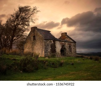 Ruined Irish cottage sitting derelict in the countryside