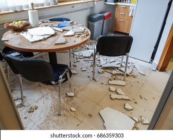 Ruined kitchen by collapsed ceiling.