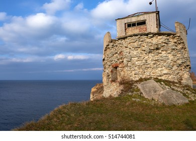 ruined lighthouse on the sea shore