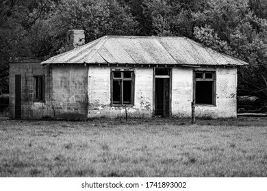 A Ruined Old Farm House Sits Abandoned In The South Island, New Zealand