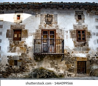Ruined old house with blazon in northern Spain