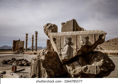 Ruined portrait of persian mans warriors in Persepolis (Unesco World Heritage). Relief on stone of abandoned city Persepolis. Shiraz, Iran.