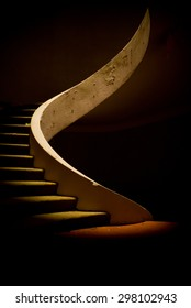 Ruined spiral staircase in dramatic lighting