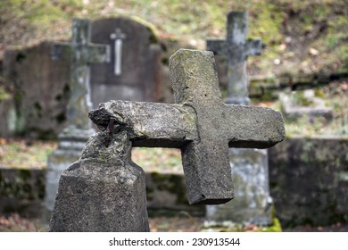 Ruined tombstone in old weathered cemetery