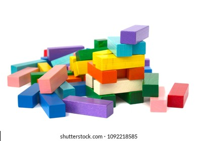Ruined tower from colorful wooden blocks isolated on white