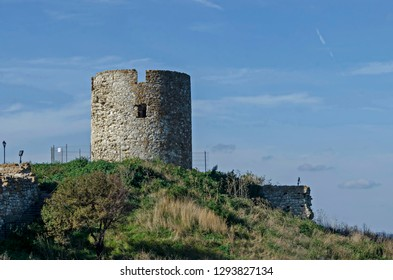 Ruined watch tower and stone with brick walls around Western fortification in ancient city Nessebar or Mesembria on the Black Sea coast, Bulgaria, Europe