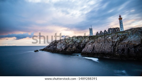 The ruins of the abbey of Saint-Mathieu de Fine-Terre and the lighthouse, Finistere, Brittany, France