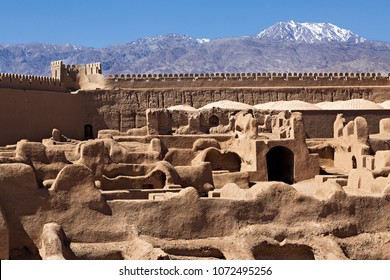Ruins of adobe medieval town in Rayen, Iran.