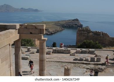 Ruins of ancient Doric temple of Athena Lindia under amazing Lindos beach and nature in  Lindos, Rhodes island. Lindos-Rhodes Island/Greece 05/17/2019