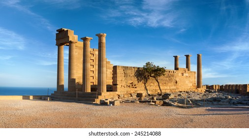 Ruins of ancient Doric temple of Athena Lindia under interesting clouds, Lindos, Rhodes island, Greece