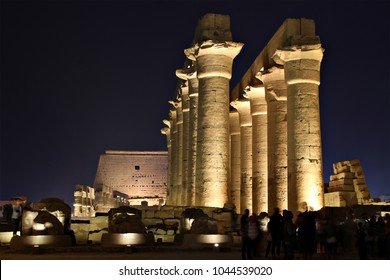The ruins of the ancient Egyptian Luxor Temple in Luxor, Egypt, lit up at dusk.