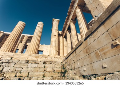 Ruins of the ancient greek historical monument - Parthenon viewed from the outside. Parthenon is a part of Athenian Acropolis in Athens, Greece.