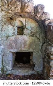 Ruins of ancient Greek and Roman ancient city of Olympos, near Cirali village in Antalya. April 2018, Antalya-Turkey
