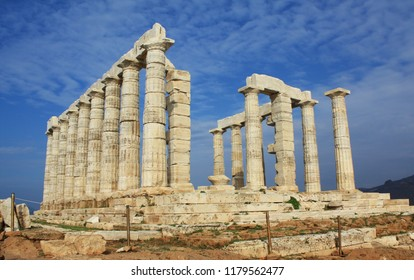 Ruins of ancient Greek Temple of Poseidon, god of the sea in Greek mythology, on Cape Sounion, near Athens, Greece, under the warm light of sunset. Built ca.440 BC.