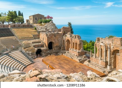 Ruins of the Ancient Greek Theater in Taormina on a sunny summer day with the mediterranean sea. Province of Messina, Sicily, southern Italy.