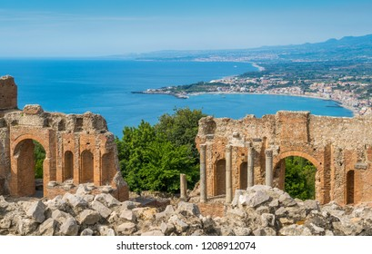 Ruins of the Ancient Greek Theater in Taormina with the sicilian coastline. Province of Messina, Sicily, southern Italy.
