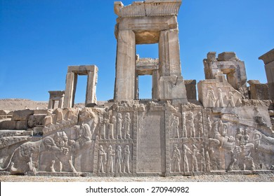 Ruins of ancient palace with columns and bas-relief with symbols of Zoroastrians - fighting bull and a lion, Persepolis, modern Iran. Persepolis was a capital of the Achaemenid Empire (550 - 330 BC)