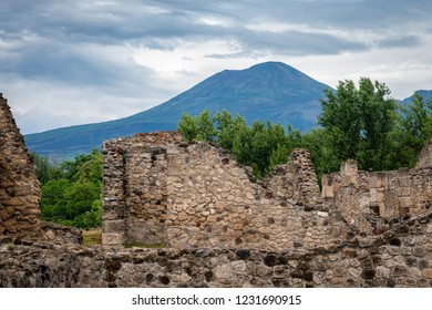 Ruins of the ancient Roman city of Pompeii, which was buried under ash and pumice after the 79 AD volcanic eruption of  Mount Vesuvius (background) is now  an archaeological site in southern Italy.