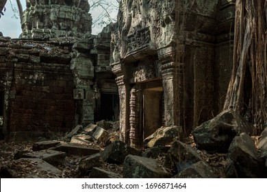 The ruins of the ancient temple of Angkor Wat, Cambodia. Ruined walls. Ancient city overgrown with trees.