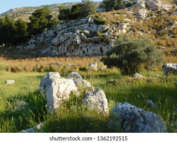 Ruins of the ancient temple of Aphrodite, or Venus, in Attica, Greece. The holes on the rock are for lovers to place their offerings
