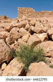 Ruins of ancient tower on the rocky hill in Masada fortress in Israel