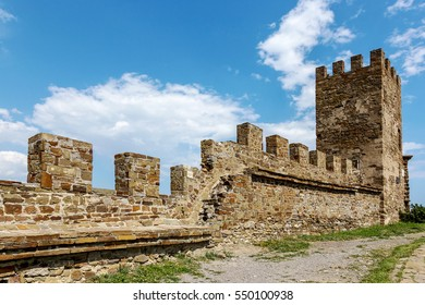 The ruins of the ancient Turkish fortress in Crimea, Sudak. The ruins of the ancient city. The fortress on the cliffs. Ruined wall of ancient medieval fortress. Remains of an ancient fortress
