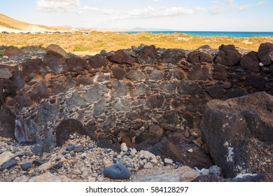 the ruins of the ancient wall, Ancient wall detail, background of sand dunes and the ocean