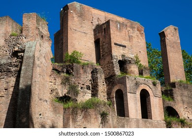 Ruins of an antique monumental fountain called Trofei di Mario built in 226 AD and  located at Piazza Vittorio Emanuele II in Rome