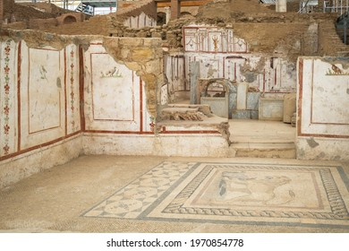 Ruins of antique terrace houses in Ephesus ancient city. Ancient rooms with fresco painting on walls and floor mosaics, Selcuk province, Turkey