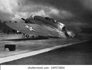 Ruins of a B-17C aircraft rests near at Hickam Field after the Japanese attack on Pearl Harbor, Dec. 7, 1941. Nearly half of the approx. 60 airplanes at Hickam Field had been destroyed or damaged.