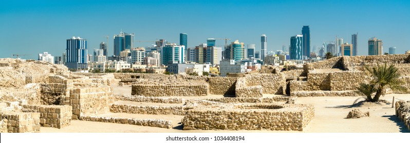 Ruins of Bahrain Fort with Manama skyline. A UNESCO World Heritage Site in the Middle East