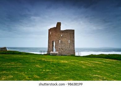 Ruins of Ballybunion castle on the coast of Atlantic ocean, Ireland