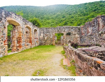 the ruins of boiling house with jamaica train furnace at right side in annaberg sugar mill plantation of US virgin islands national park st. thomas usa
