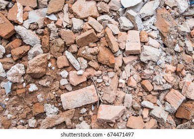 Ruins of brick rubble in construction site after demolition work.