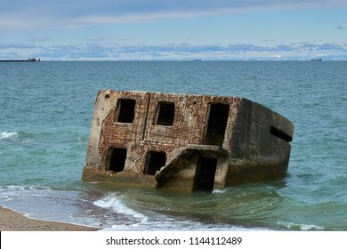 Ruins of bunkers on the beach of the Baltic sea, part of an old fort in the former Soviet base Karosta in Liepaja, Latvia.