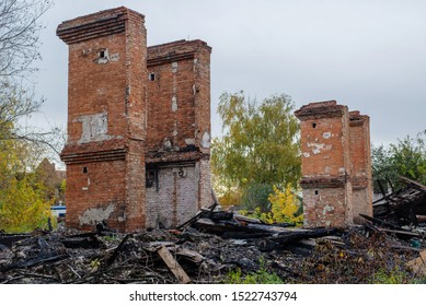 ruins of a burned house in autumn