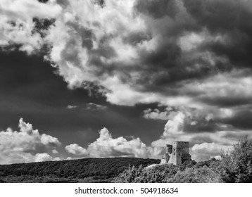 Ruins of a castle in Csesznek, Veszprem, Hungary with Sky and Clouds