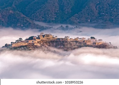 The ruins of a castle floating on a sea of clouds, Takeda Castle, Japan