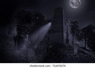 Ruins of castle Helfenburk in mystery moonlight. Czech republic.