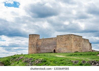 Ruins of the castle of Medinaceli in Soria, Spain (9th century), against a cloudy sky.