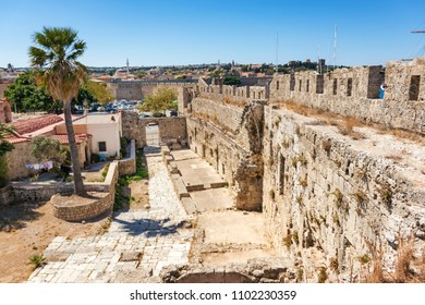 Ruins of city walls in old town of Rhodes (Rhodes, Greece)