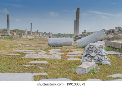 Ruins of colonnaded antique street with damaged Corinthian capital,  broken columns and paved with marble plates. Side, Turkey - Shutterstock ID 1991303573