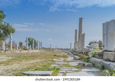 Ruins of colonnaded antique street paved with marble plates during the daytime. Side, Turkey - Shutterstock ID 1991305184