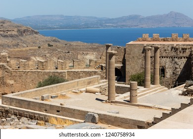 Ruins and columns of an ancient temple at the Acropolis of Lindos, Rhodes, Greece