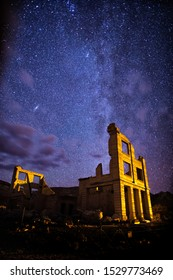 Ruins of the Cook Bank Building in Rhyolite Ghost Town, Nevada stand under the winter Milky Way and the Andromeda Galaxy.