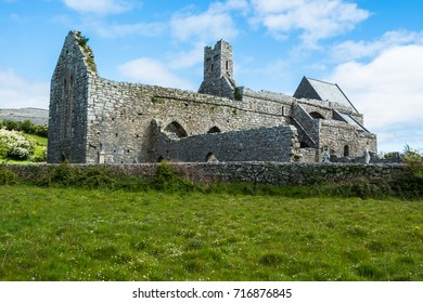 Ruins of Corcomroe Abbey, a Cistercian monastery located in the north of the Burren region of County Clare in Ireland.