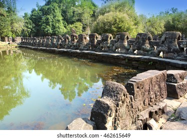 ruins of a fencing of a sacred reservoir when approaching to the temple Neak Pean near Siem Reap, Cambodia