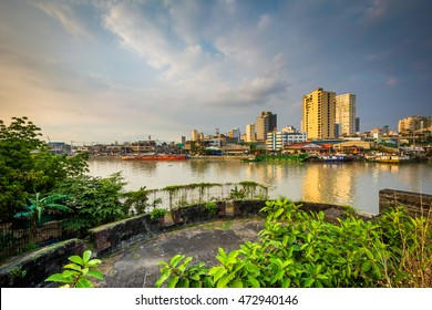 Ruins at Fort Santiago and buildings along the Pasay River, in Intramuros, Manila, The Philippines.